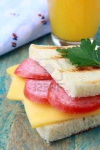 9427327-breakfast-sandwich-with-cheese-and-salami-and-juice